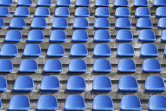Plastic blue seats on football stadium Royalty Free Stock Photos