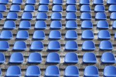 Plastic blue seats on football stadium royalty free stock photos