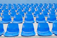 Plastic blue seats in a stadium Royalty Free Stock Image