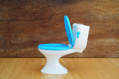 Plastic blue and white toilet  toy Stock Images