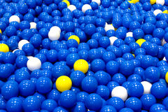 Plastic blue, yellow and white balls, ball toys background Royalty Free Stock Photo