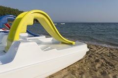 Plastic boat near by the seashore Stock Image