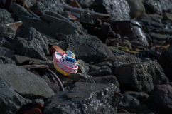 Plastic boat. A plastic boat washed ashore Royalty Free Stock Images
