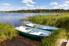 Plastic boats at the lake in summer day Royalty Free Stock Image