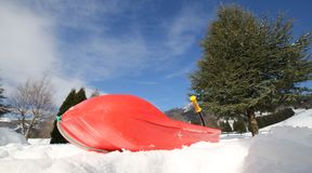 Plastic bob for playing in the snow in mountains Royalty Free Stock Photography