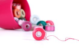 Plastic bobbins with thread of different colors Stock Images