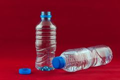 Plastic bottle. A green plastic bottle for water on red background Royalty Free Stock Images