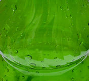 Plastic bottle. Green plastic bottle with water. A background, macro Stock Image