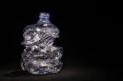 Plastic bottle. On black background, ecologic concept Royalty Free Stock Photography
