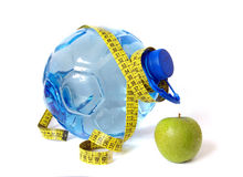 Plastic bottle and apple on white Royalty Free Stock Image