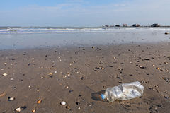 Plastic bottle on the beach Royalty Free Stock Photography