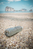Plastic bottle on the beach Stock Photos