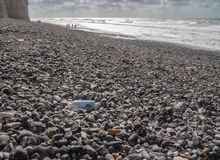 Plastic bottle blown onto the rocky beach at Birling Gap, Sussex stock image