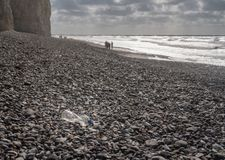 Plastic bottle blown onto the rocky beach at Birling Gap, Sussex stock images