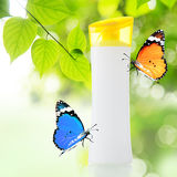 Plastic bottle and butterfly Stock Photos