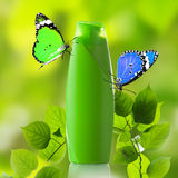 Plastic bottle and butterfly Royalty Free Stock Photos