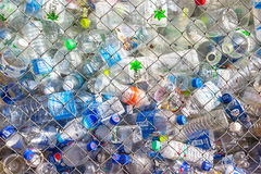 Plastic bottle in cage Royalty Free Stock Images