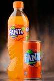 Plastic bottle and can of carbonated soft drink Fanta Royalty Free Stock Photography