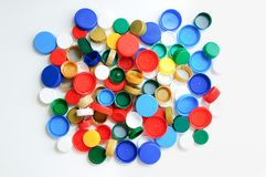 Plastic bottle caps on a white background. royalty free stock photos