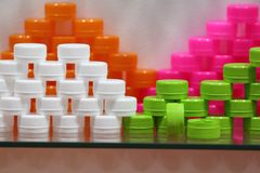 Free Plastic Bottle Caps ; White Green Pink Orange Colors Royalty Free Stock Photography - 151378387