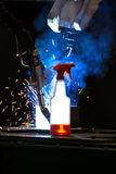 Plastic bottle with cleaning liquid glowing in front CNC Mig wel Royalty Free Stock Images