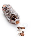 Plastic Bottle and Coins Royalty Free Stock Photos