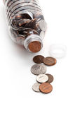 Plastic Bottle and Coins Royalty Free Stock Image
