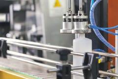 Plastic bottle on conveyer. Manufacturing plastic bottle on conveyer, close up royalty free stock images