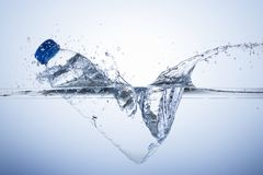 Plastic bottle dive with splash Royalty Free Stock Photography