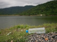 Plastic bottle is dumped by tourists stock images
