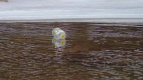Plastic bottle floating in the mountain river stock video footage