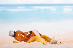 Plastic bottle and food waste in  sand on  beach. Stock Images