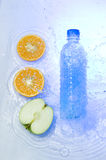 Plastic bottle with fruit Stock Images