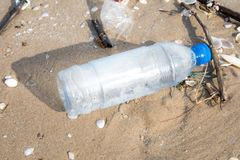 Plastic bottle or garbage on the sand beach. Royalty Free Stock Photo