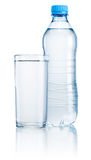 Plastic bottle and glass of drinking water  on white Royalty Free Stock Images