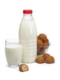 Plastic bottle, glass with milk and a vase with doughnuts. It is isolated on white Stock Image