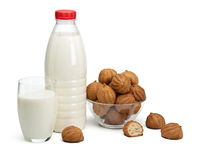 Plastic bottle, glass with milk and a vase with doughnuts Royalty Free Stock Photo