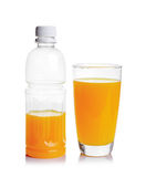 Plastic bottle and glass of orange juice Royalty Free Stock Photo