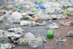 Plastic bottle on the ground and more trash. A lot of trash in the ground Stock Photography