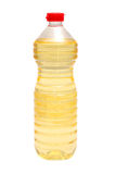Plastic bottle with liquid on the white. Plastic bottle with a yellow liquid on the white royalty free stock photography