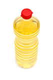 Plastic bottle with liquid on the white. Plastic bottle with a yellow liquid on the white Stock Photo