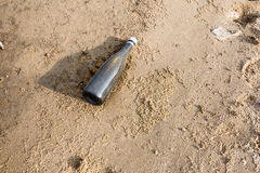 Plastic Bottle Litter on the Beach Royalty Free Stock Photography