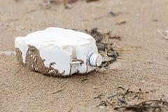 Plastic bottle litter on the beach Royalty Free Stock Image