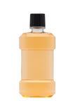 Plastic bottle of mint orange mouthwash. Isolated on white background Royalty Free Stock Photos