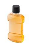 Plastic bottle of mint orange mouthwash. Isolated on white background Royalty Free Stock Photo