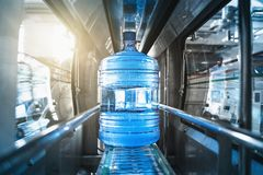 Free Plastic Bottle Or Gallon Of Purified Drinking Water Inside Automated Conveyor Production Line. Water Factory Royalty Free Stock Image - 159784116