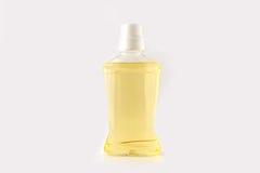 Plastic bottle of orange mouthwash Royalty Free Stock Images