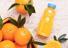 Plastic bottle of raw organic fresh orange juice Royalty Free Stock Photo