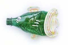 Plastic bottle recycled in a fish figure. Reuse garbage royalty free stock photography