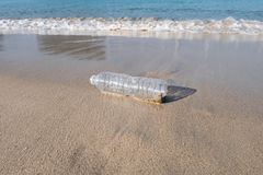 Plastic bottle on sand beach. Pollution of the beach royalty free stock images